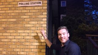 Martin outside polling station