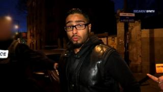 A file image grab from BFMTV footage shows Jawad Bendaoud, the man who allegedly lent his Paris suburb apartment to the suspected ringleader of the attacks on Paris, being arrested in Saint-Denis.