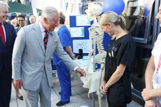 Prince Charles, Prince of Wales meets hospital staff as he visits Ysbyty Aneurin Bevan