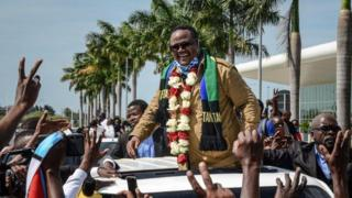 Tundu Lissu (C), Tanzania's former MP with the Chadema main opposition party, who was shot 16 times in a 2017 attack, reacts to supporters as he returns after three years in exile to challenge President John Magufuli in elections later this year, at Julius Nyerere International Airport in Dar es Salaam, Tanzania, on July 27, 2020. - Tanzania will hold a general election on October 28, 2020