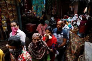 People queue in New Delhi