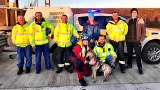Nico with his rescuers