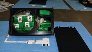 Police-supplied picture of the drug packages inside an opened stereo speaker during examination