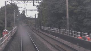 workers on both side of the tracks