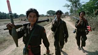 Heavily armed Cambodian government soldiers patrol on a remote 'road' in 1992