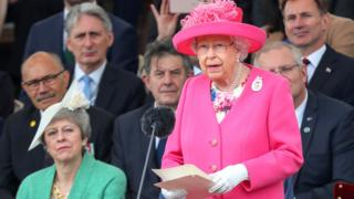The Queen stands to give a speech