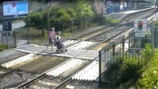 mother pushing pram at Wareham crossing on 11.5.09