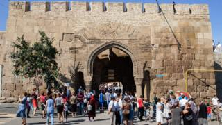 A file picture taken on September 19, 2015 shows people walking in front of the Naryn-Kala Fortress in Derbent