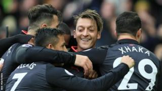 Mesut Ozil (centre) provided a goal and assist during Arsenal's 5-2 win at Everton on Sunday