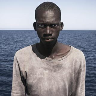 Amadou Sumaila in front of the sea moments after being rescued from a migrant boat