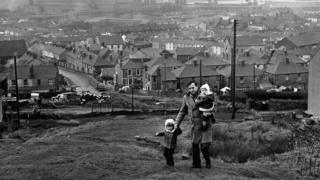 Steelworker and his children walking in 1964