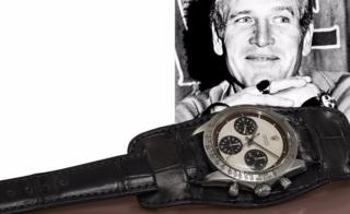 Photo of Paul Newman next to his watch