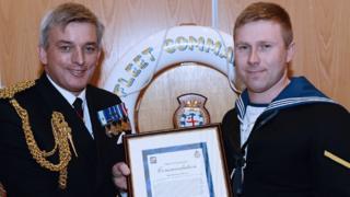 Jonathan Murray, right, receiving his award