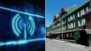 A wi-fi symbol and the Metropole Hotel in Llandrindod Wells