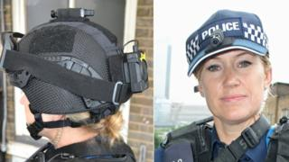 Armed police officer wearing head camera