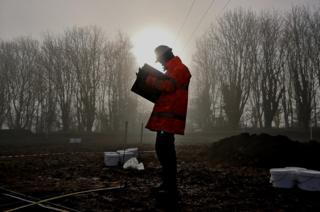 A man standing in mist