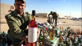 Soldiers inspecting seized alcohol