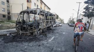 A burnt bus in the northern Brazilian city of Fortaleza
