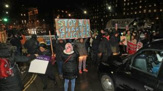 Campaigners outside Downing Street, London, protest against government plans to deport 50 people to Jamaica