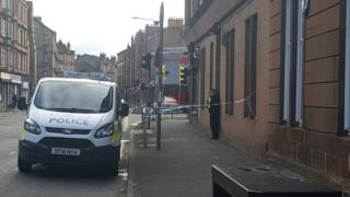 Police van and tape