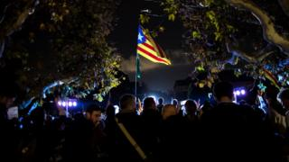 People attend a gathering in support of the members of the dismissed Catalan cabinet