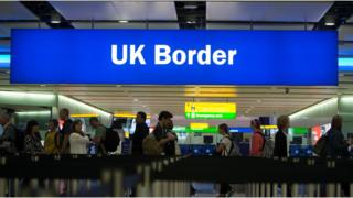 File photo from 2014 showing passengers passing through border controls at Heathrow Airport.