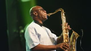 "Emmanuel N""Djoke Dibango, known as Manu Dibango performs during his concert at the Ivory Hotel Abidjan in 2018"