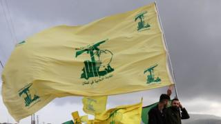 Hezbollah supporters fly the group's flag in Lebanon