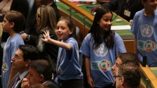 Children at the signing ceremony for the Paris Agreement.