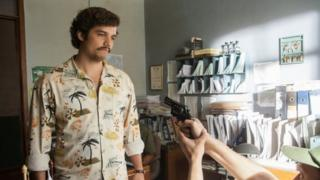 "This image released by Netflix shows Wagner Moura as Pablo Escobar in the Netflix Original Series ""Narcos."" In a partnership with Univision, the Netflix series will air on the network."