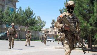 Afghan security forces arrive at the site of an attack in Helmand province on 13 May, 2015