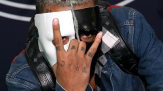 XXXTentacion wears a half-black, half-white mask