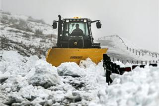 A vehicle clears snow in the Yorkshire Dales