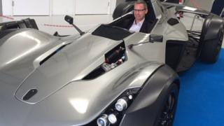 James Baker, commercial director of the National Graphene Institute, sits in the world's first car with graphene in its bodywork