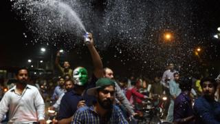 Pakistani cricket fans celebrate winning the International Cricket Championship (ICC) Champions Trophy final cricket match against India