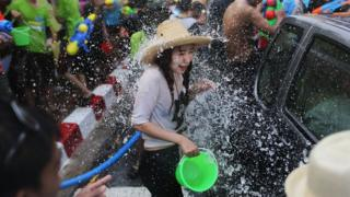 Tourists and Thai residents take part in a city-wide water fight during the Songkran water festival on April 14, 2014
