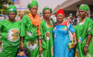 Group of women wearing green and blue attire
