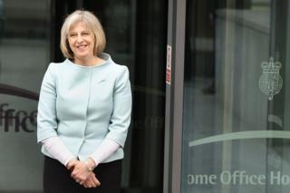 Theresa May stands at the Entrance to the Home Office in May 2010