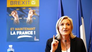 "FN leader Marine Le Pen with Brexit poster saying ""And now France!"", 24 Jun 16"