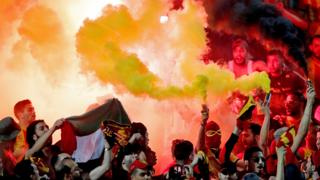 in_pictures Esperance football fans holding flares at the al-Ahly Stadium in Cairo, Egypt - Friday 28 February 2020