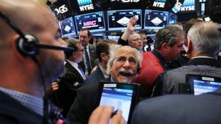Traders on the floor of the New York Stock Exchange the morning after Donald Trump won the presidential election on 9 Nov, 2016