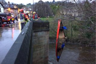 Canoe being lifted from the River Derwent