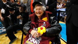 Sister Jean celebrates her team win after defeating Kansas State Wildcats last weekend