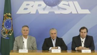 Senator Renan Calheiros (left) and Chamber of Deputies Speaker Rodrigo Maia joined Mr Temer at the press conference