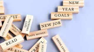 New Year resolutions written on wooden blocks