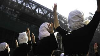 A group of women cover their faces during a demonstration in Santiago, Chile, 06 June 20