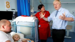 Boris-Johnson-visits-a-young-child-in-hospital.