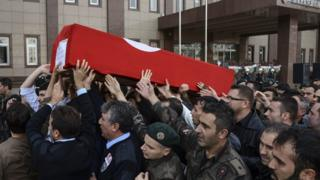 Turkish police carry coffin of comrade killed in clash with suspected IS militants, 26 Oct 15