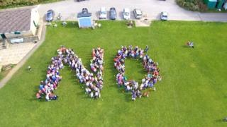 """Protestors spell out the word """"no"""""""