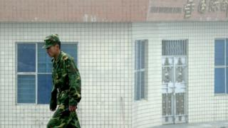 A Chinese soldier stands guard on the Chinese side of the border in 2008